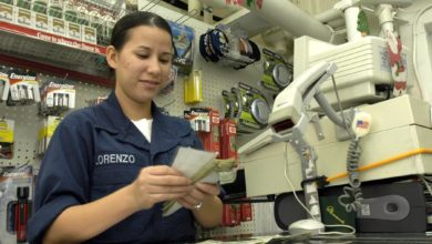 050103-N-9079D-020 Indian Ocean (Jan. 3, 2005) - Seaman Jaimee Lorenzo counts money while working as a clerk in the ship store aboard the guided missile destroyer USS Benfold (DDG 65). Benfold, assigned to Carrier Strike Group Nine (CSG-9), is currently conducting humanitarian operations in the wake of the Tsunami that struck South East Asia. CSG-9 is currently operating in the Indian Ocean off the waters of Indonesia and Thailand. U.S Navy photo by Photographer's Mate Airman Ronald Dallatorre (RELEASED)